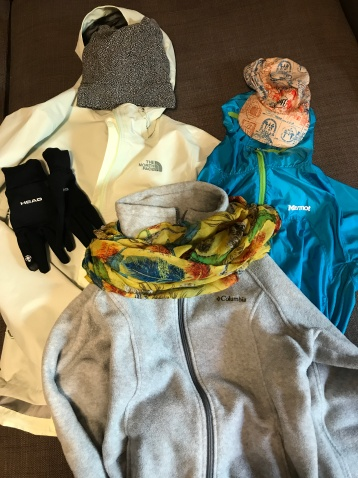 Rainjacket, beanie, gloves, windbreaker, buff hat, scarf and fleece