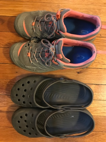 Well-worn hiking shoes and crocs